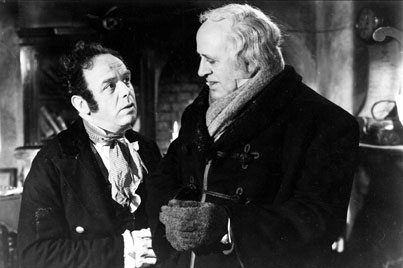 Bob Cratchit (Mervyn Johns) and Scrooge